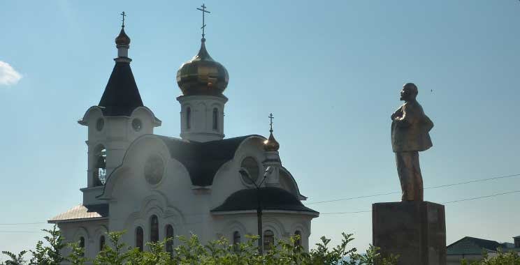 Interesting how Lenin statue and Church are side by side...